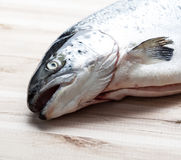 Salmon fish on wooden plate Stock Photos