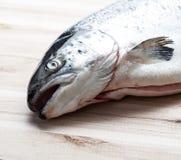 Salmon fish on wooden plate.  Stock Photos