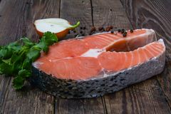 Salmon fish on a wooden table Royalty Free Stock Images