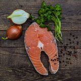 Salmon fish on a wooden table Stock Images