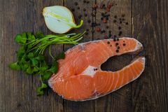 Salmon fish on a wooden table Royalty Free Stock Photo