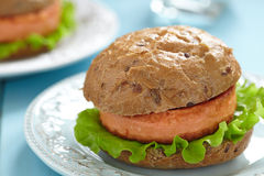 Salmon fishburger sandwich Royalty Free Stock Photos