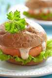 Salmon fishburger sandwich Royalty Free Stock Image