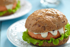 Salmon fishburger sandwich Royalty Free Stock Photography
