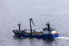Salmon fishing boat setting out on Tongass Narrows at Ketchikan Stock Image
