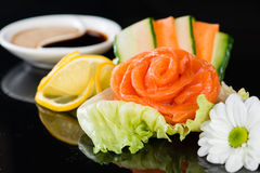 Salmon flower rose, sashimi sushi. Against a dark background Royalty Free Stock Photo