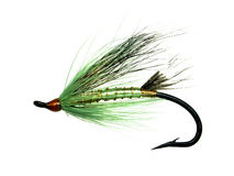 Salmon fly. For fly fishing with feathers and glitter tied on a hook Stock Photo