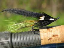 Salmon fly. On fly fishing rod Stock Images