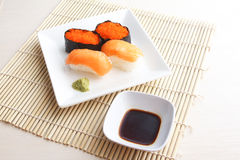 Salmon and flying fish roe sushi on plate Royalty Free Stock Images
