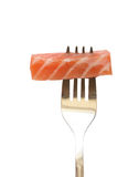 Salmon On The Fork. Steel fork with slice of salmon isolated on white background Stock Image