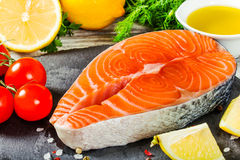 Salmon with fresh green herbs, cherry tomato,olive oil and lemon Stock Photography