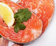 Salmon. Fresh raw salmon red fish steak. Isolated on white Royalty Free Stock Photo