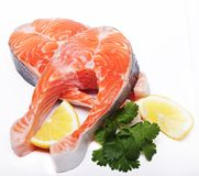 Salmon. Fresh raw salmon red fish steak. Isolated on white Stock Photos