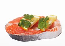 Salmon. Fresh raw salmon red fish steak. Isolated on white Stock Images