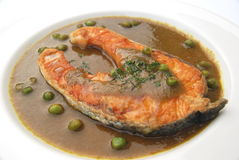 Salmon fried with green chili sauce Royalty Free Stock Images