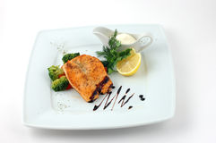 Salmon fried with spices Royalty Free Stock Image