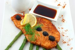 Salmon fried with spices Stock Images