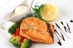 Salmon fried with spices Royalty Free Stock Images
