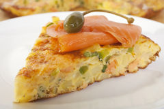 Salmon Frittata with Caperberry. Frittata with two types of smoked salmon - hot smoked salmon is contained within the frittata, along with potatoes, onion, green royalty free stock image