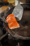 Salmon in the frying pan Stock Images