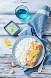 Salmon with Garlic Lemon Butter Sauce and rice. On a wood background. toning. selective focus Royalty Free Stock Images