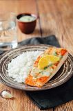 Salmon with Garlic Lemon Butter Sauce and rice. On a wood background. toning. selective focus Royalty Free Stock Photos