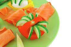 Salmon on green Stock Photos