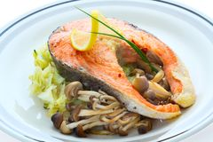 Salmon, grilled with mushrooms and cabbage in the Stock Image