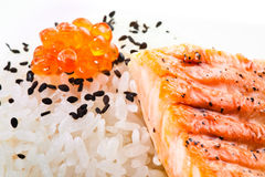 Salmon grilled with rice and red caviar Royalty Free Stock Photos
