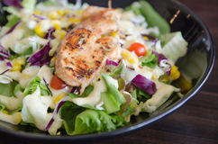 Salmon grilled Salad. Grilled Salmon Fillet over Green Salad Plate Stock Photo