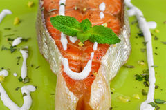 Salmon. Grilled salmon served with creamy sauce and mint Royalty Free Stock Photography