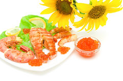 Salmon grilled steak, grilled shrimp and red caviar on a white b Royalty Free Stock Images