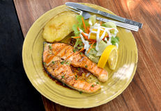Salmon grilled steak with pepper sauce Stock Images