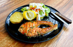 Salmon grilled steak with pepper sauce Stock Image