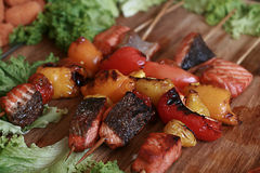 Salmon with grilled vegetables on skewers Stock Photography