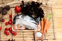 Salmon head and salt , pepper for cooking. Stock Images