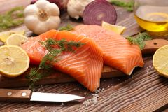 Salmon with herb and lemon. On board royalty free stock photo