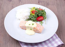 Salmon with hollandaise sauce and rice Stock Images