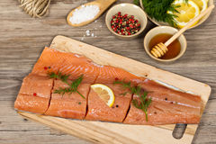 Salmon with honey marinade ready to cook Royalty Free Stock Image