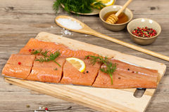 Salmon with honey marinade ready to cook Royalty Free Stock Images