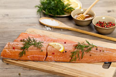 Salmon with honey marinade ready to cook Royalty Free Stock Photos