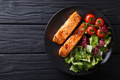 salmon in honey-soy glaze and fresh vegetable close-up. Horizontal top view stock images