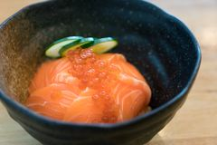 Salmon Ikura Don - Japanese cuisine, Salmon and Roe Rice Bowl in table at  Japanese food restaurant stock images