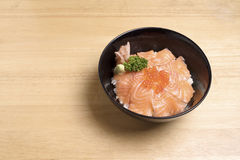 Salmon ikura don on the wood table. Royalty Free Stock Images