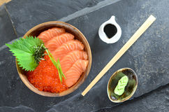 Salmon and Ikura in wood bowl Stock Images