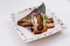 Salmon Kabutoni is Salmon Head Bolied with Shiitake, Mushroom, Carrot and Tofu in Soy Sauce Stock Photos
