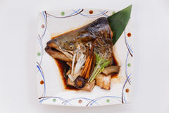 Salmon Kabutoni is Salmon Head Bolied with Shiitake, Mushroom, Carrot and Tofu in Soy Sauce Royalty Free Stock Images