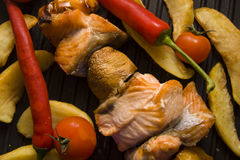 Salmon kebab and potato on grill Stock Photo