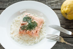 Salmon with knife and fork Stock Image