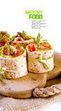 Salmon lavash rolls with fresh salad leafs Stock Photos